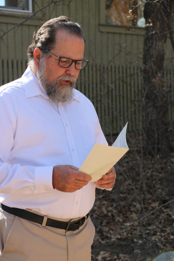 Chaplain Don, holding the wedding vows during a ceremony.