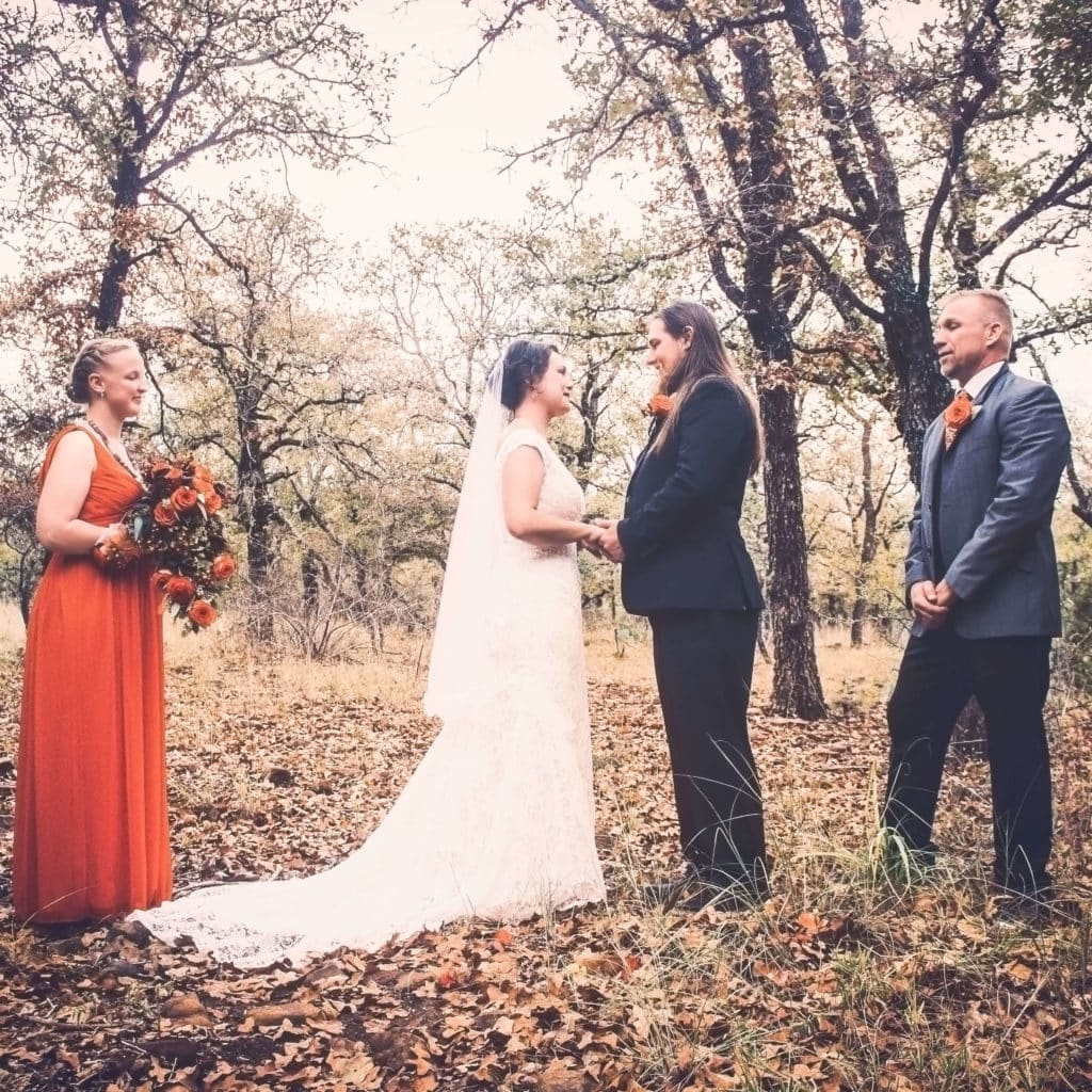 eloping couple in the texas hill country woods
