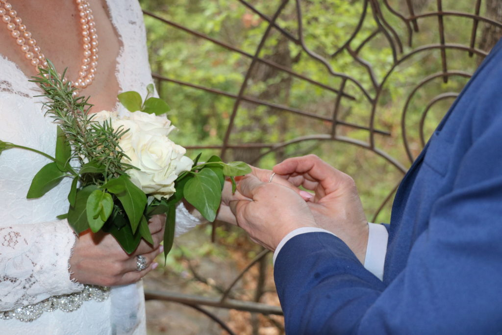 couple exchanging rings at an elopement