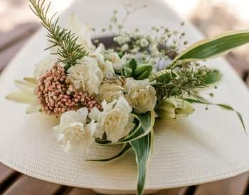 Beautiful wedding bouquet of white flowers with baby's breath and greenery